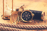 vintage compass and nautical items on ancient world map