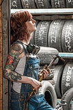 Woman with tattoos holding welding torch
