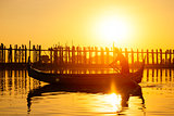 Fishman under U bein bridge at sunset