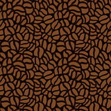 Seamless pattern made up of coffee beans in brown.