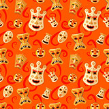 Different wooden voodoo masks on red background seamless pattern