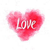 Love lettering on watercolor heart abstract background