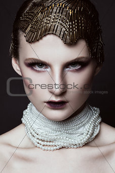 Beauty make up with glamour hairstyle pearls