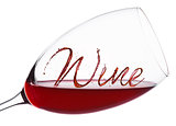 Glass of red wine with wine font splash and drops
