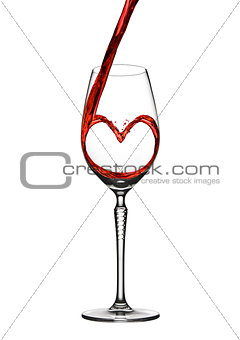 Pouring wine heart romantic shape to elegant glass