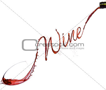 Pouring red wine from bottle to the glass
