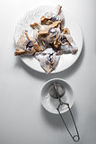 Hamantaschen Cookies for Purim on a white plate.