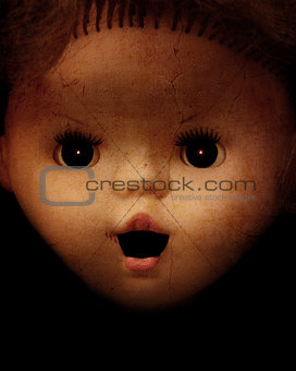 Grunge background with vintage evil spooky doll face