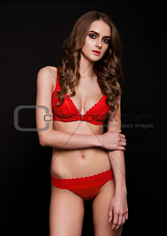 Beautiful sexy girl wearing red fancy lingerie