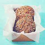 Chocolate oat cookies in craft paper, close-up