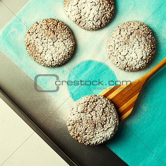 Fresh baked chocolate cookies in sugar powder