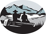 Two Trampers Sitting on Log Lake Mountain Oval Woodcut