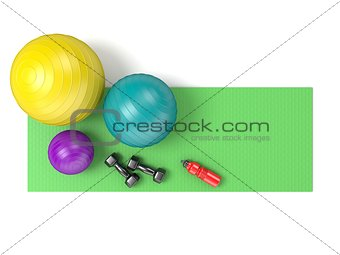 Fitness ball, dumbbells and plastic water bottle on green yoga m