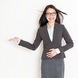 Businesswoman hand showing something