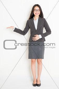 Asian businesswoman showing something