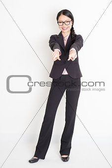Asian businesswoman fingers pointing on you