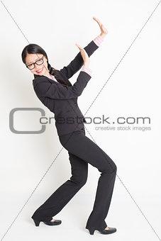 Asian businesswoman defending something