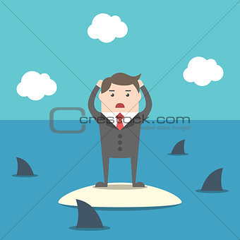 Businessman among sharks