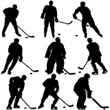 Set of silhouettes hockey player. Isolated on white.
