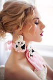 Fashion photo of beautiful girl wearing handmade accessories