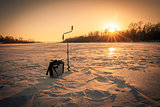 Ice fishing on sunrise