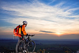 cyclist on mountain-bike  background of beautiful sunset.