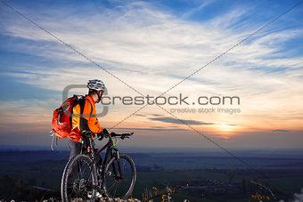 cyclist on mountain-bike  background of beautiful sunset.
