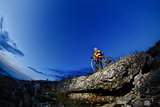 Mountain biker in action across rocks