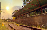 Abandoned railway station at sunset