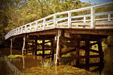 Rustic vintage white wooden bridge