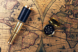 vintage compass and spyglass on ancient world map