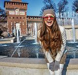happy modern woman near Sforza Castle in Milan, Italy