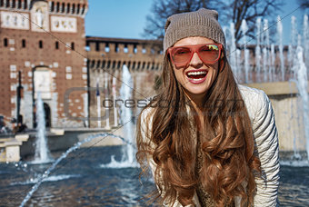Portrait of happy modern traveller woman in Milan, Italy