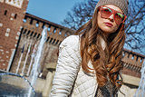young woman in Milan, Italy looking into distance