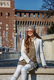 woman in front of Sforza Castle in Milan sitting near fountain