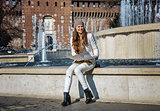 smiling woman near Sforza Castle in Milan, Italy with map