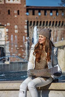 tourist woman near Sforza Castle in Milan having excursion