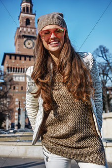 Portrait of happy young tourist woman in Milan, Italy