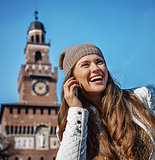 woman near Sforza Castle in Milan speaking on mobile phone
