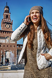 traveller woman near Sforza Castle, Milan speaking on cell phone
