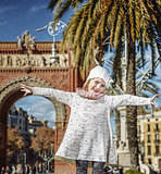 happy trendy girl in Barcelona, Spain rejoicing