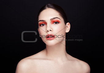 Beauty red eyes and lips makeup fashion model