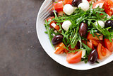 mozzarella salad with tomatoes and green arugula