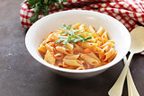 penne pasta with tomato sauce in a white plate