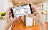 Hands Holding Smart Phone Displaying Drawing of Kitchen Photo Be