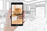 Hand Holding Smart Phone Displaying Photo of Kitchen Drawing Beh