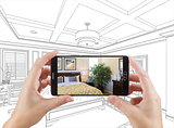 Hands Holding Smart Phone Displaying Photo of Bedroom Drawing Be