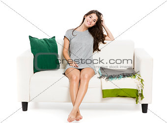 Beautiful woman relaxing on a sofa