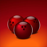 Bowling balls on a red background.