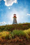 Lighthouse on background blue sky with cloud